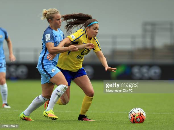 Manchester City Women's Izzy Christiansen and Doncaster Rovers Belles' Carla Humphrey battle for the ball