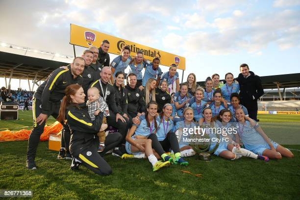 Manchester City Women's players celebrate winning the FA WSL Continental Tyres Cup Final against Birmingham City Ladies with manager Nick Cushing on...
