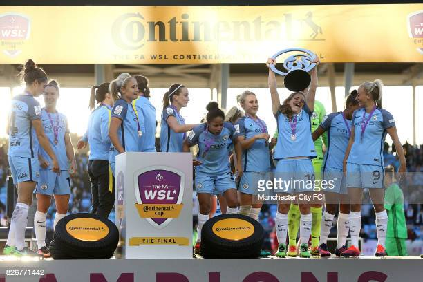 Manchester City Women's players celebrate winning the FA WSL Continental Tyres Cup Final against Birmingham City Ladies