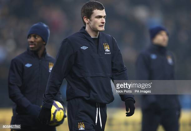 Manchester City's Adam Johnson warms up during the half time interval
