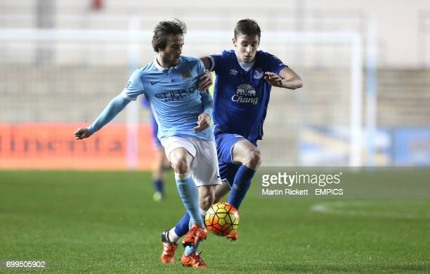 Manchester City's Aleix Garcia battles for the ball with Everton's Joe Williams