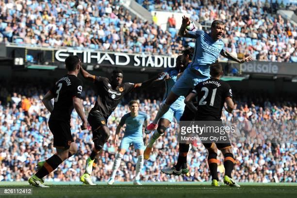 Manchester City's Aleksandar Kolarov and Hull City's Michael Dawson in action during the Barclay's Premiership match at the Etihad Stadium Manchester...