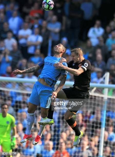 Manchester City's Aleksandar Kolarov and Hull City's Michael Dawson battle for the ball