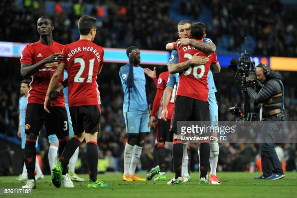 Manchester City's Aleksandar Kolarov and Manchester United's Matteo Darmian in action during the Barclay's Premiership match at the Etihad Stadium...