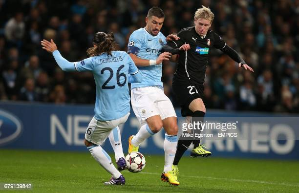 Manchester City's Aleksandar Kolarov and Martin Demichelis battle for the ball with Plzen's Frantisek Rajtoral