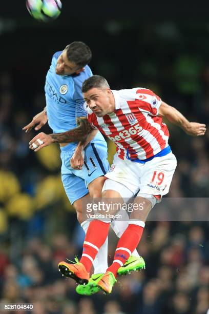 Manchester City's Aleksandar Kolarov and Stoke City's Jonathan Walters battle for the ball
