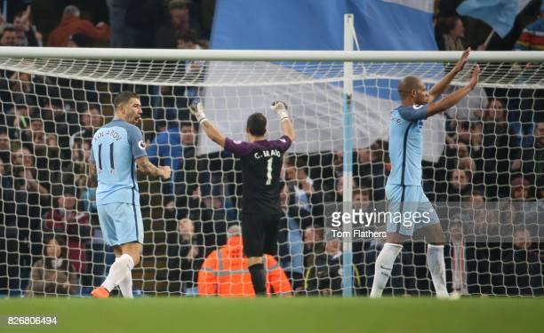 Manchester City's Aleksandar Kolarov celebrates after beating Arsenal