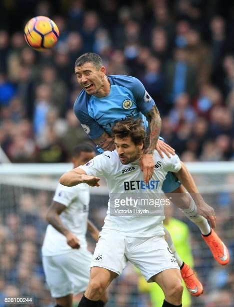 Manchester City's Aleksandar Kolarov heads the ball away from Swansea City's Fernando Llorente