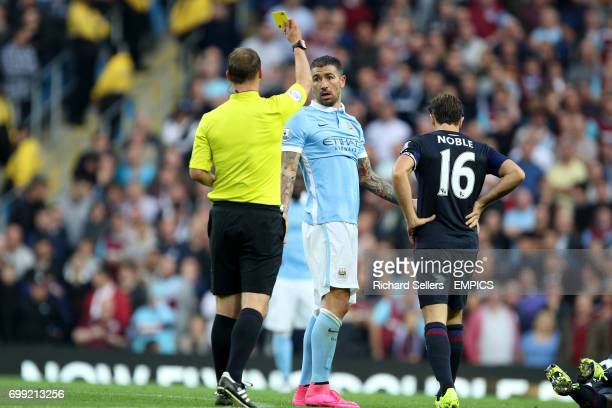 Manchester City's Aleksandar Kolarov is booked by referee Robert Madley