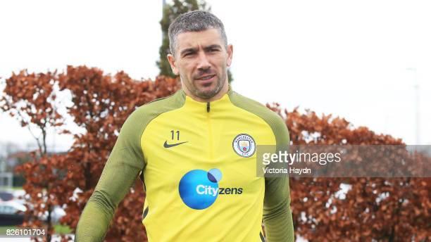 Manchester City's Aleksandar Kolarov walking to training
