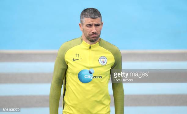Manchester City's Aleksandar Kolarov walks to training
