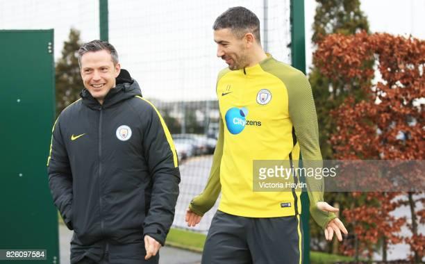 Manchester City's Aleksandar Kolarov with coach Sam Erith