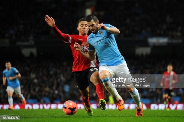 Manchester City's Alvaro Negredo and Blackburn Rovers's Adam Henley battle for the ball