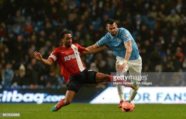 Manchester City's Alvaro Negredo and Blackburn Rovers's Lee Williamson battle for the ball