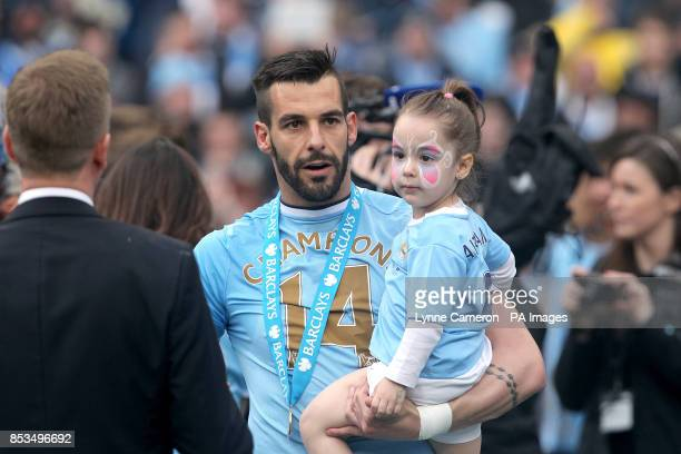 Manchester City's Alvaro Negredo and his daughter during the post match celebrations