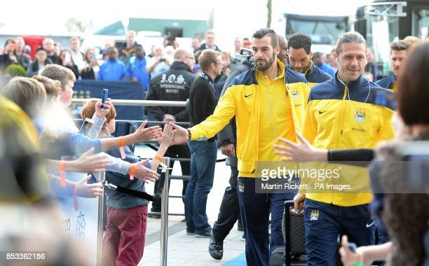 Manchester City's Alvaro Negredo and Martin Demichelis arrive for the Barclays Premier League match at the Etihad Stadium Manchester