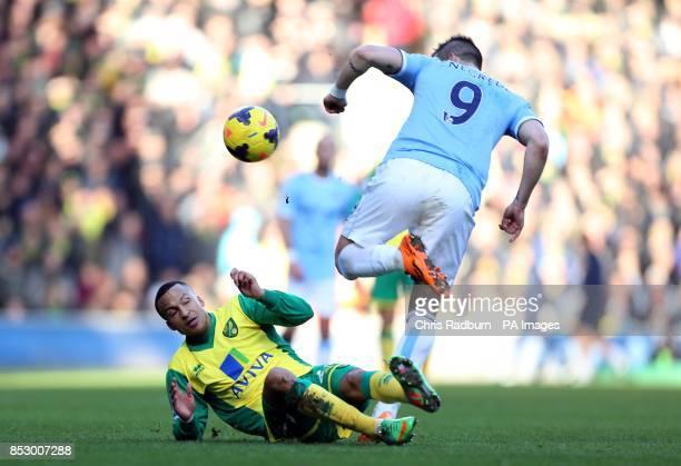 Manchester City's Alvaro Negredo and Norwich City's Martin Olsson battle for the ball