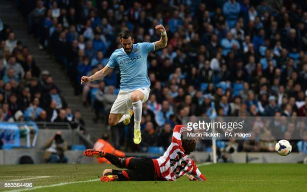 Manchester City's Alvaro Negredo and Sunderland's Marcos Alonso battle for the ball