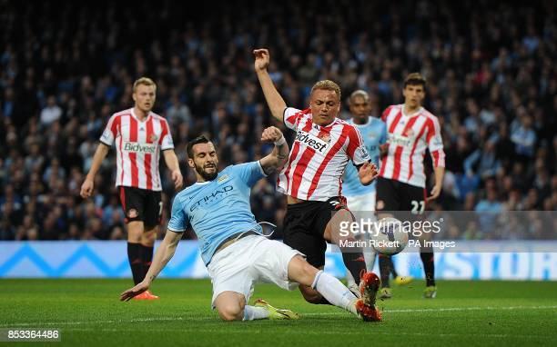 Manchester City's Alvaro Negredo and Sunderland's Wes Brown battle for the ball