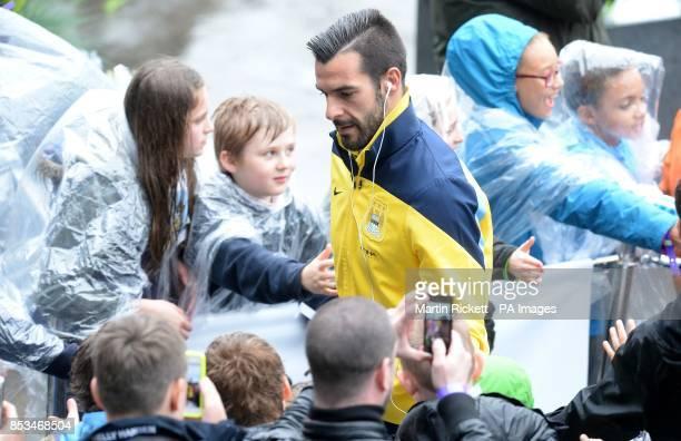 Manchester City's Alvaro Negredo arrives for the Barclays Premier League match at the Etihad Stadium Manchester