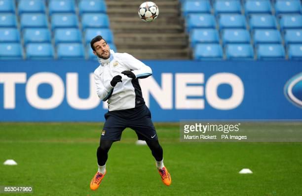 Manchester City's Alvaro Negredo heads the ball during the training session at the Etihad Stadium Manchester