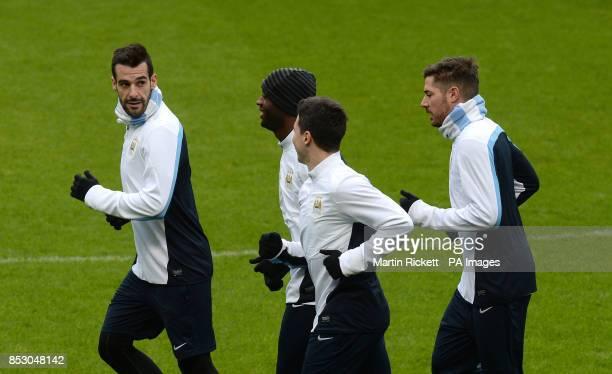 Manchester City's Alvaro Negredo Samir Nasri Yaya Toure and Javi Garcia during the training session at the Etihad Stadium Manchester