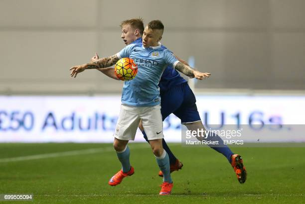 Manchester City's Angel Tasende battles for the ball with Everton's Harry Charsley