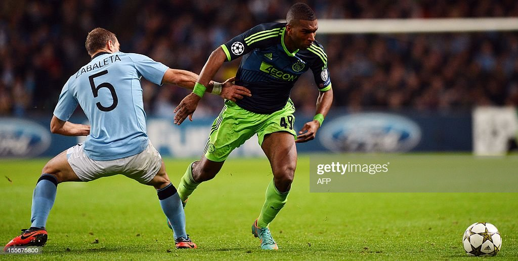 Manchester City's Argentian defender Pablo Zabaleta (L) and Ajax's Dutch forward Ryan Babel compete during the UEFA Champions League Group D football match between Manchester City and Ajax at The Etihad Stadium in Manchester, north-west England, on November 6, 2012.