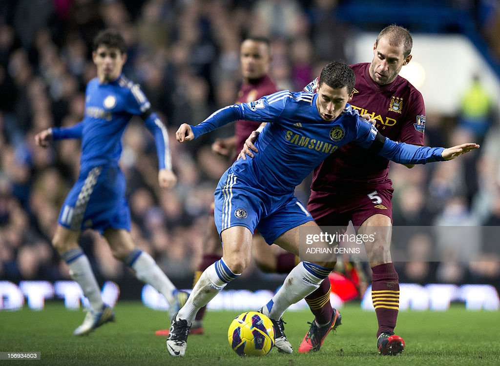 "Manchester City's Argentian defender Pablo Zabaleta (R) challenges Chelsea's Belgian player Eden Hazard (2nd R) during the English Premier League football match between Chelsea and Manchester City at Stamford Bridge stadium in London on November 25, 2012. AFP PHOTO/ADRIAN DENNIS USE. No use with unauthorized audio, video, data, fixture lists, club/league logos or ""live"" services. Online in-match use limited to 45 images, no video emulation. No use in betting, games or single club/league/player publications"