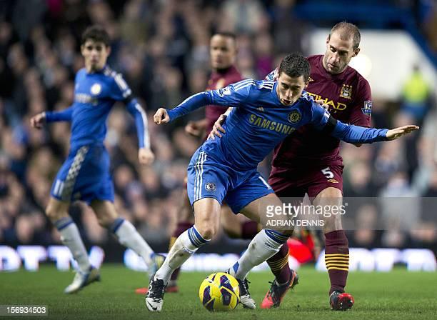 Manchester City's Argentian defender Pablo Zabaleta challenges Chelsea's Belgian player Eden Hazard during the English Premier League football match...