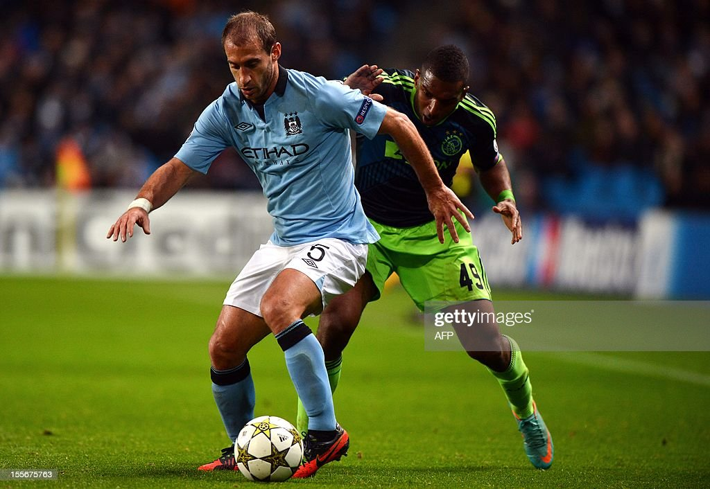 Manchester City's Argentian defender Pablo Zabaleta (L) controls the ball from Ajax's Dutch forward Ryan Babel during the UEFA Champions League Group D football match between Manchester City and Ajax at The Etihad Stadium in Manchester, north-west England, on November 6, 2012.