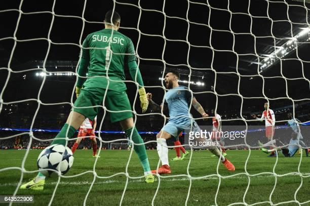 TOPSHOT Manchester City's Argentinian defender Nicolas Otamendi celebrates after Manchester City's English defender John Stones scored their fourth...