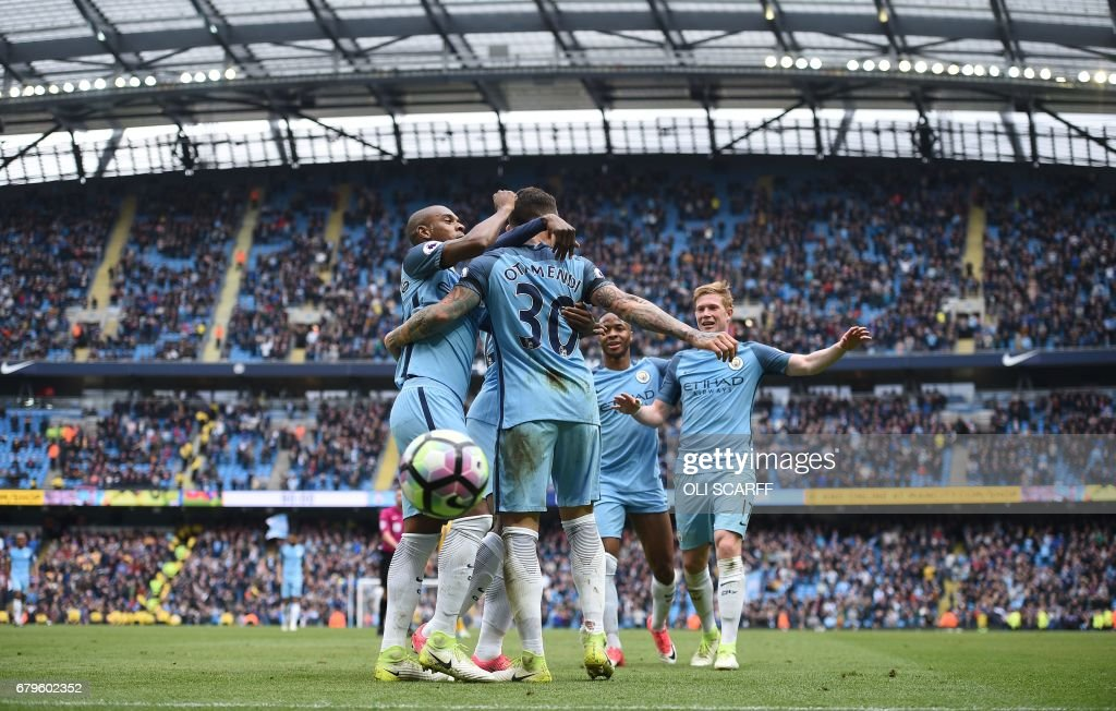 Manchester City's Argentinian defender Nicolas Otamendi (C) celebrates scoring his team's fifth goal during the English Premier League football match between Manchester City and Crystal Palace at the Etihad Stadium in Manchester, north west England, on May 6, 2017. Manchester City won the match 5-0. / AFP PHOTO / Oli SCARFF / RESTRICTED TO EDITORIAL USE. No use with unauthorized audio, video, data, fixture lists, club/league logos or 'live' services. Online in-match use limited to 75 images, no video emulation. No use in betting, games or single club/league/player publications. /