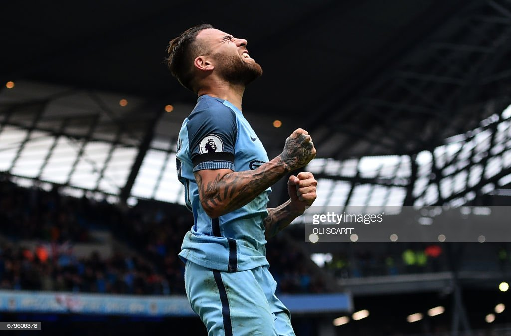 Manchester City's Argentinian defender Nicolas Otamendi celebrates scoring his team's fifth goal during the English Premier League football match between Manchester City and Crystal Palace at the Etihad Stadium in Manchester, north west England, on May 6, 2017. Manchester City won the match 5-0. / AFP PHOTO / Oli SCARFF / RESTRICTED TO EDITORIAL USE. No use with unauthorized audio, video, data, fixture lists, club/league logos or 'live' services. Online in-match use limited to 75 images, no video emulation. No use in betting, games or single club/league/player publications. /