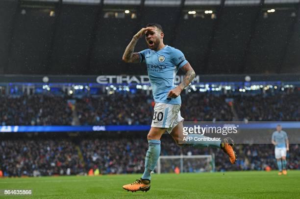 Manchester City's Argentinian defender Nicolas Otamendi celebrates scoring his team's second goal during the English Premier League football match...