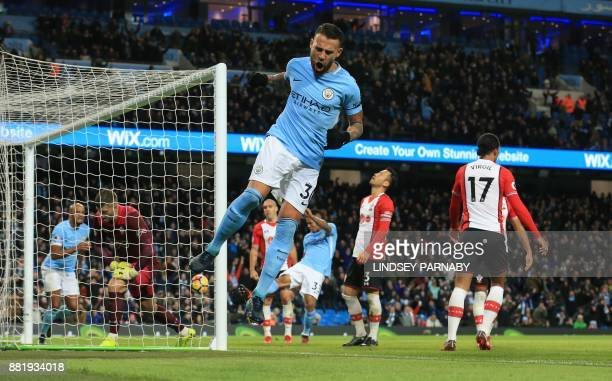 Manchester City's Argentinian defender Nicolas Otamendi celebrates after claiming his teams' first goal which went in off of Southampton's Dutch...