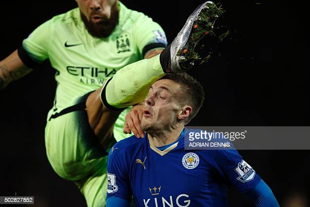 TOPSHOT Manchester City's Argentinian defender Nicolas Otamendi clears the ball under pressure from Leicester City's English striker Jamie Vardy...
