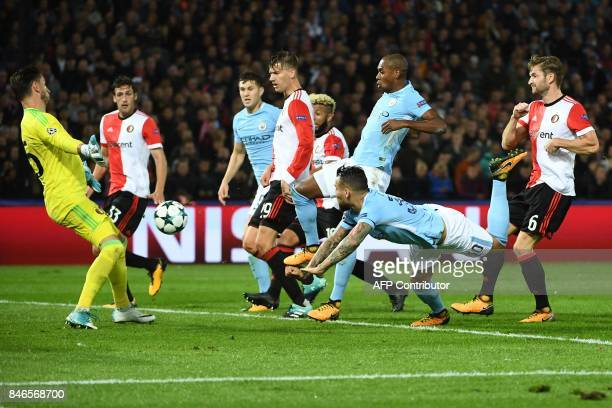 Manchester City's Argentinian defender Nicolas Otamendi heads the ball during the UEFA Champions League Group F football match between Feyenoord...