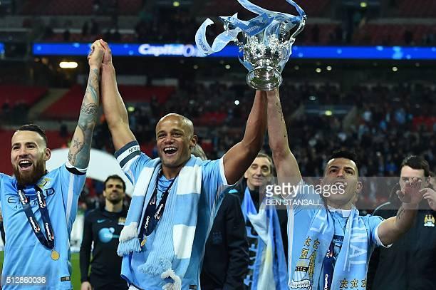 Manchester City's Argentinian defender Nicolas Otamendi Manchester City's Belgian defender Vincent Kompany and Manchester City's Argentinian striker...