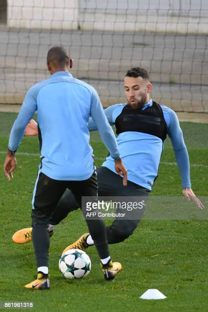 Manchester City's Argentinian defender Nicolas Otamendi slides in to make a tackle during a team training session at the City Football Academy in...