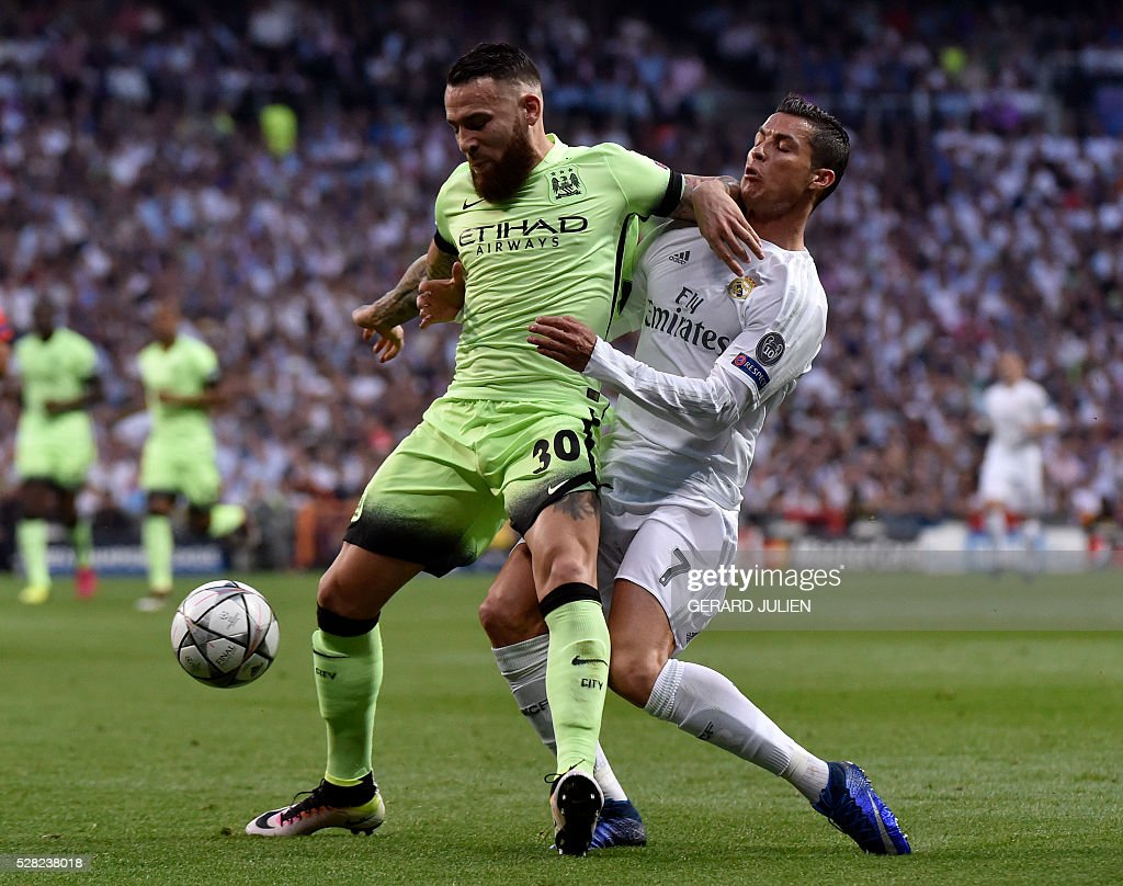 Manchester City's Argentinian defender Nicolas Otamendi (L) vies with Real Madrid's Portuguese forward Cristiano Ronaldo during the Champions League semi-final second leg football match between Real Madrid CF and Manchester City at the Santiago Bernabeu stadium in Madrid on May 4, 2016. / AFP / GERARD