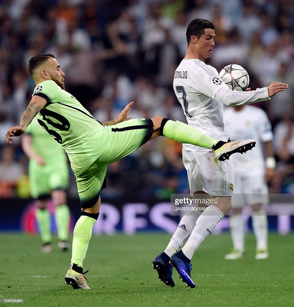 Manchester City's Argentinian defender Nicolas Otamendi (L) vies with Real Madrid's Portuguese forward Cristiano Ronaldo during the UEFA Champions League semi-final second leg football match Real Madrid CF vs Manchester City FC at the Santiago Bernabeu stadium in Madrid, on May 4, 2016. / AFP / JAVIER