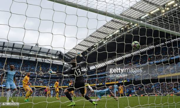 Manchester City's Argentinian defender Nicolas Otamendi watches the ball after heading to score his team's fifth goal during the English Premier...