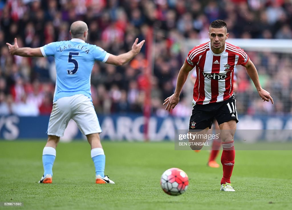 Manchester City's Argentinian defender Pablo Zabaleta (L) reacts after being fouled by Southampton's Serbian midfielder Dusan Tadic during the English Premier League football match between Southampton and Manchester City at St Mary's Stadium in Southampton, southern England on May 1, 2016. / AFP / BEN STANSALL / RESTRICTED TO EDITORIAL USE. No use with unauthorized audio, video, data, fixture lists, club/league logos or 'live' services. Online in-match use limited to 75 images, no video emulation. No use in betting, games or single club/league/player publications. /