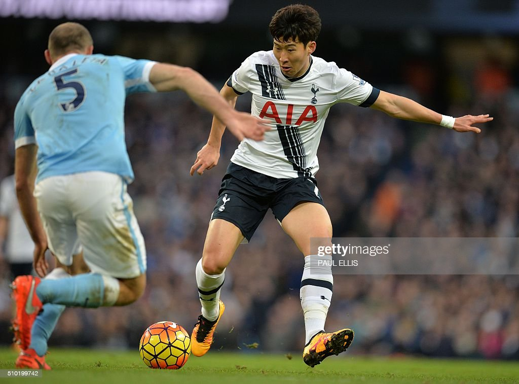 Manchester City's Argentinian defender Pablo Zabaleta (L) vies with Tottenham Hotspur's South Korean striker Son Heung-Min during the English Premier League football match between Manchester City and Tottenham Hotspur at the Etihad Stadium in Manchester, north west England, on February 14, 2016. / AFP / PAUL ELLIS / RESTRICTED TO EDITORIAL USE. No use with unauthorized audio, video, data, fixture lists, club/league logos or 'live' services. Online in-match use limited to 75 images, no video emulation. No use in betting, games or single club/league/player publications. /