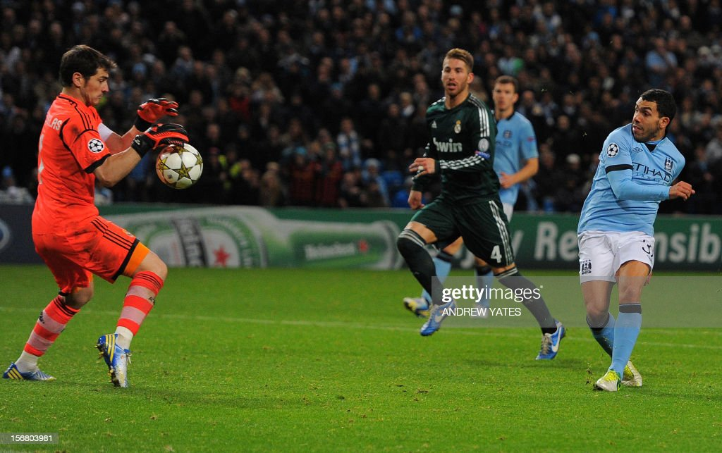 Manchester City's Argentinian forward Carlos Tevez (R) has his shot saved by Real Madrid's Spanish goalkeeper Iker Casillas (L) during the UEFA Champions League group D football match between Manchester City and Real Madrid at The Etihad Stadium in Manchester, north-west England, on November 21, 2012.
