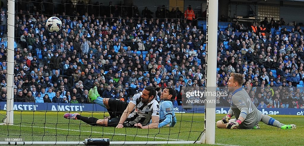 """Manchester City's Argentinian forward Carlos Tevez (C) scores the opening goal during the English Premier League football match between Manchester City and Newcastle United at The Etihad stadium in Manchester, north-west England on March 30, 2013. USE. No use with unauthorized audio, video, data, fixture lists, club/league logos or """"live"""" services. Online in-match use limited to 45 images, no video emulation. No use in betting, games or single club/league/player publications. """""""