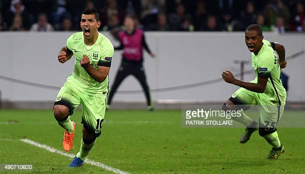Manchester City's Argentinian forward Sergio Aguero celebrates scoring with his teammates during the UEFA Champions League firstleg Group D football...