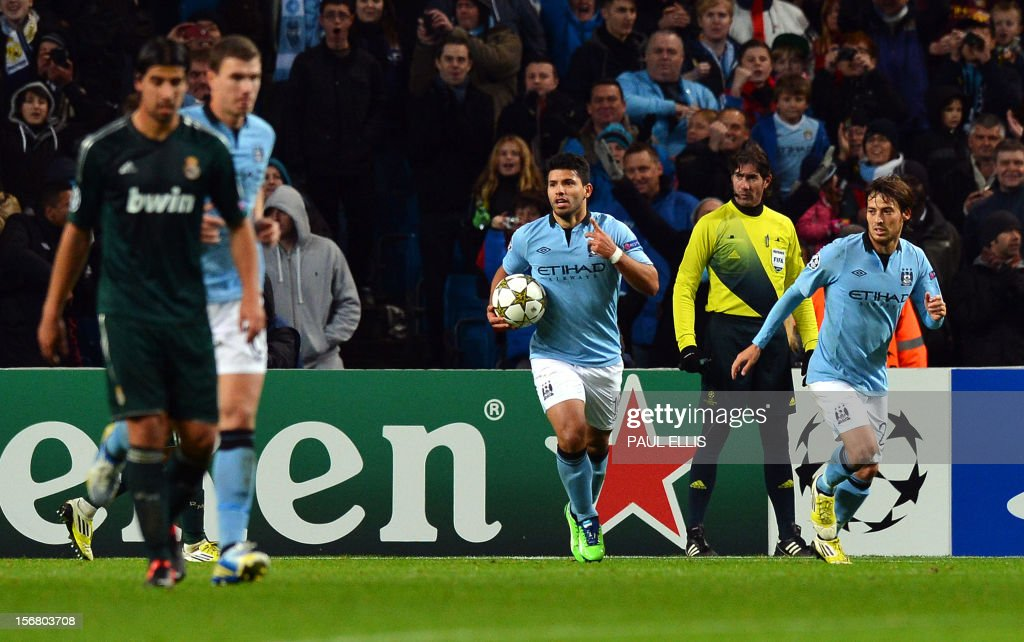 Manchester City's Argentinian forward Sergio Aguero (C) collects the ball after scoring a penalty during the UEFA Champions League group D football match between Manchester City and Real Madrid at The Etihad Stadium in Manchester, north-west England, on November 21, 2012.