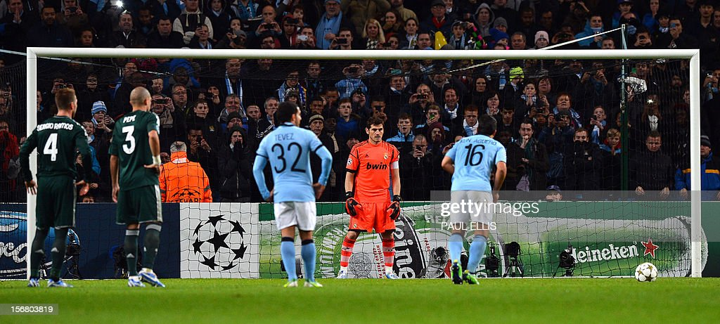 Manchester City's Argentinian forward Sergio Aguero scores a penalty during the UEFA Champions League group D football match between Manchester City and Real Madrid at The Etihad Stadium in Manchester, north-west England, on November 21, 2012. AFP PHOTO / PAUL ELLIS